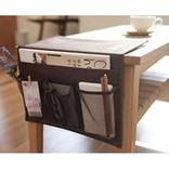 テーブルやこたつ、ベッドサイドに差し込むだけ。スッキリ片付く収納ポケット