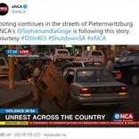 暴動で盗み出したテレビをどうしても車に積み込みたい男 視聴者「入るわけがない」と嘲笑(南ア)<動画あり>
