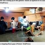「命よりゲーム?」台風で洪水発生もネットカフェでゲームする少年たち(フィリピン)<動画あり>